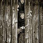 playful kids in barn by Lorne Chesal