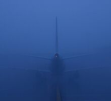 Airbus tail in the blue fog by jim stewart