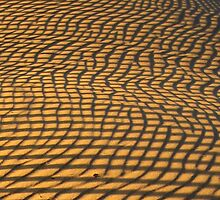 Stripes reflected onto sand to create patterns by Robin Fortin IPA