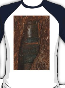 Ned Kelly Armour buried in old tree trunk T-Shirt