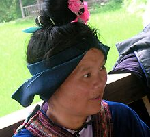 Miao woman in traditional outfit by Julien Bertrand