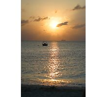 Sun setting over departing cruise ship Photographic Print