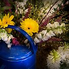 Flowers in a Blue Watering Can by Mike  Savad