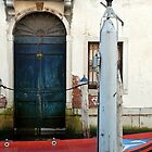 Blue door, red boat by mjds