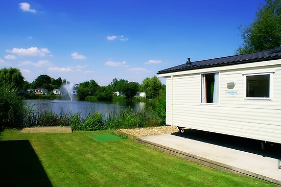 Caravan - Looking Over The Lake With Clear Blue Skies by Joel Kempson