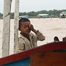 Long day at work on Tonle Sap River, Cambodia by Leigh Penfold
