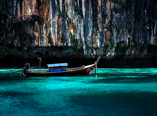 Longboat off Phi Phi Island by Angela McConnell