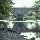 Fisherman Ouse Bridge River Derwent Lake District England 198405240017 by Fred Mitchell