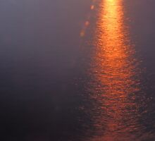Sunset Over a Misty Lake by journeysincolor