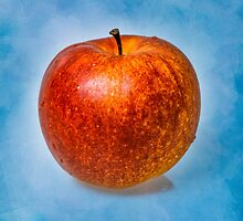 Red apple fruit against light blue background by luckypixel