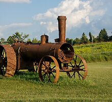 Antique And Rusty - a Vintage Iron Tractor on a Farm by Georgia Mizuleva