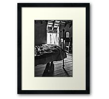 Boots under the bed Framed Print
