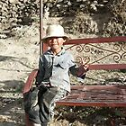 Boy on a bench by Michelle Thomson