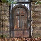 1800-something door on an old graveyard in Berlin by Nicole W.