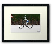 Corky's riding a bike Framed Print