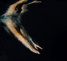 Woman dives into water photographed underwater by PhotoStock-Isra