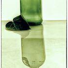 In a dark glass bottle by andreisky