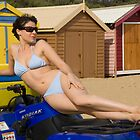 Female bikini model on rescue ATV at Brighton Beach in front of the bathing boxes by leoklein