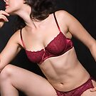Glamour model Jenny in red lingerie on black by leoklein