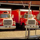 Red trucks - NYC by Pascale Baud