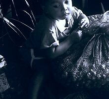 Boy At Denpasar Market Bali by Damian McGrath