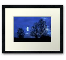 Moon between Trees - JUSTART © Framed Print