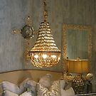 Chandelier, Cross and Bed at Bliss Home and Design by SizzleandZoom