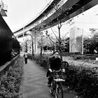Peoples' transport - Tokyo, Japan by Norman Repacholi