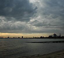 Sunsetting on a cloudy day in St Kilda by Rini Ismail