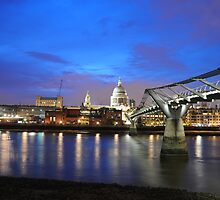 St Paul's Cathedral and London's Millennium Bridge at night. by snapperjack