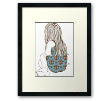 Little girl in a dress sitting back hair Framed Print