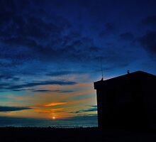 Sunset over lifeguard's hut by Ray Smith