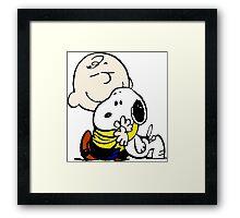 Snoopy hugs Charlie Brown Framed Print