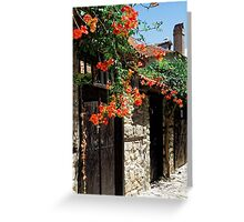 Flowers stretching out over the gates of an old house in Nessebar, Bulgaria Greeting Card
