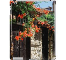 Flowers stretching out over the gates of an old house in Nessebar, Bulgaria iPad Case/Skin