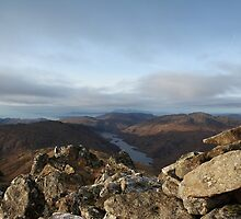 Loch Beoraid and a distant Eigg from the summit of Sgurr an Utha. by John Cameron