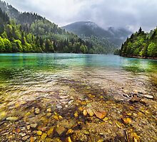 Lake in mountains, in a rainy day by naturalis