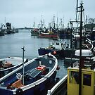 Boats at Sea Houses Bamburgh Northumberland England 198405270007m by Fred Mitchell