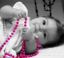 A Baby and her Beads!  by Wendy Mogul