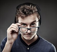Handsome teenager wearing trendy cap and glasses by naturalis