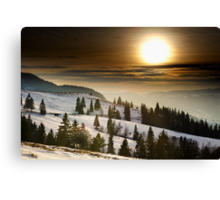 Sunset on snowy mountains Canvas Print