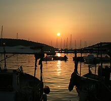 Sunset over Sivota Harbour by DRWilliams