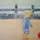 A child on the beach chasing the ball by Susan Brown
