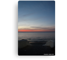 Sunset at sea with stairs Canvas Print