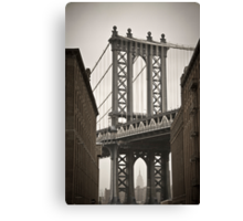 Empire State Building through arch of Manhattan Bridge Canvas Print