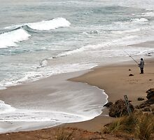 Fisherman on beach by Karin Knapp