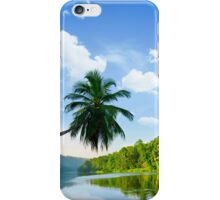 picturesque palm tree leans over the tropical river in the early hours iPhone Case/Skin