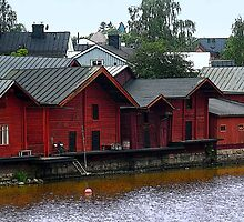 Red Storehouses in Porvoo, Finland by Catherine Sherman