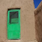 Bright green door at the Taos Pueblo in New Mexico by Ronee van Deemter