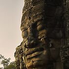 A Giant stone face in bayon Temple - Cambodia by chrisfx